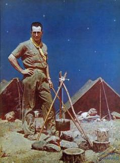 Scoutmaster in front of tents