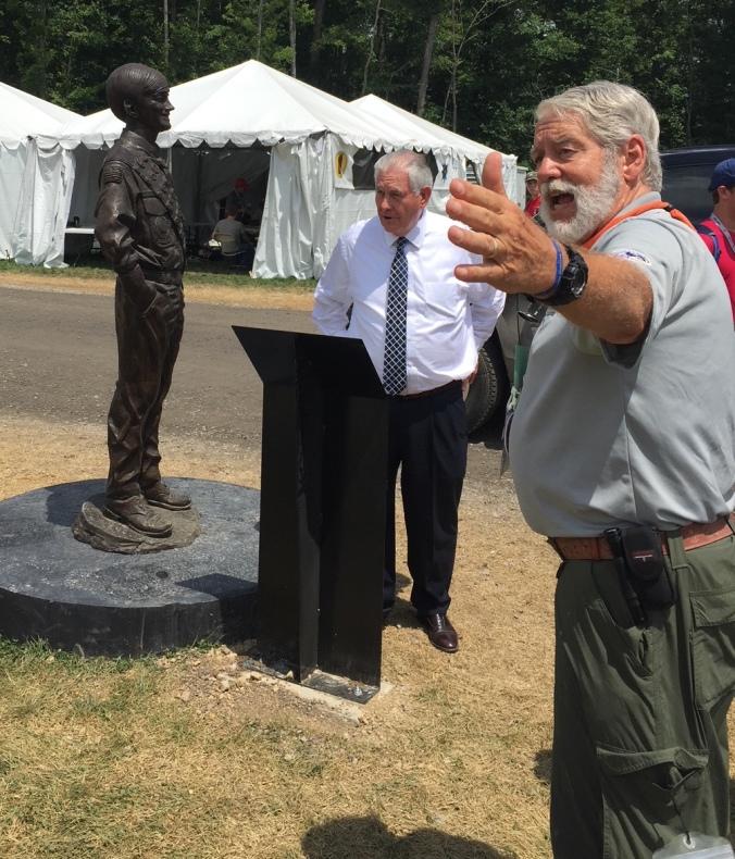 Marriot statue (l), Rex Tillerson (c), Tony Mei (r)